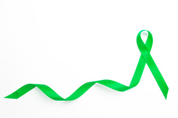 Green awareness ribbon with trail
