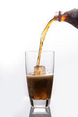 Soda pouring into glass