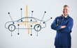 Mechanic standing in front of a background with car diagram