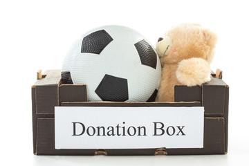 Black cardboard with football and stuffed bear
