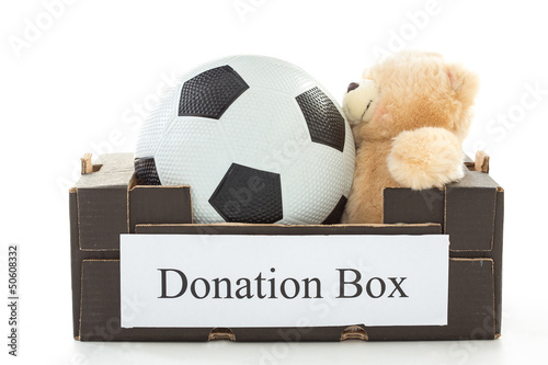Black cardboard with football and stuffed bear