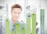 Businessman looking at green chart interface