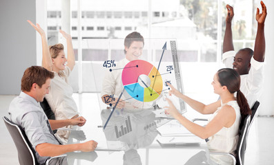 Cheerful business workers using colorful pie chart interface