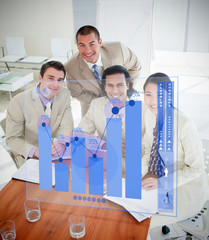 Overview of cheerful colleagues using blue chart interface