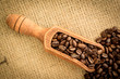 Wooden shovel full of coffee beans