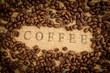 Coffee beans surrounding coffee stamp on sack