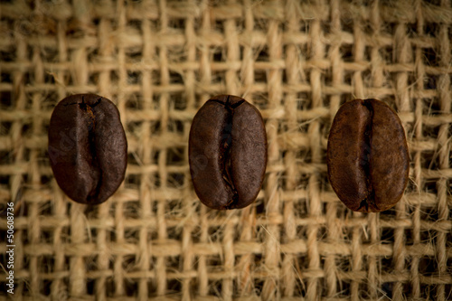 Three coffee beans in a row