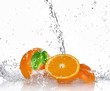 Oranges with splashing water