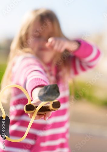 Girl Aiming With A Slingshot