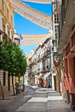 Street in Seville on summer day, Andalucia, Spain.