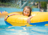 Little girl sitting on inflatable ring