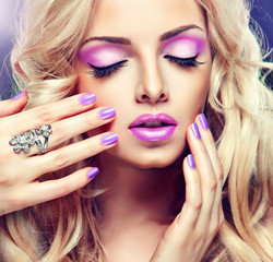 Beautiful blonde girl with lilac makeup