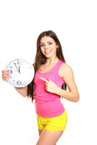 Attractive athletic girl with a clock on white background