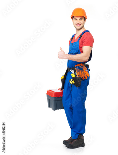 Handyman with tools showing the thumbs up sign