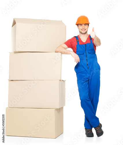 Delivery man with paper boxes and thumbs up sign