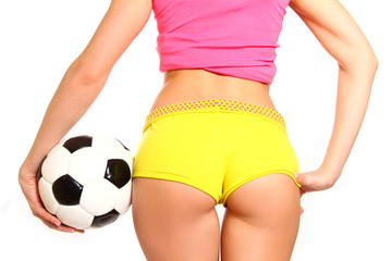 Athletic woman posing with a soccer ball on a white background,
