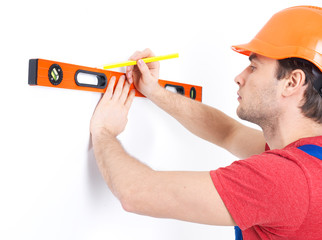 Construction worker measuring the level