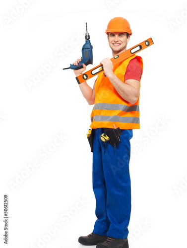 Smiling workman with tools  in uniform