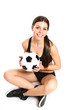 Sexy girl is sitting with a soccer ball on a white background fr