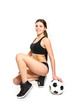 Attractive young woman posing with a soccer ball on a white back