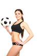 Athletic woman posing with a soccer ball on a white background
