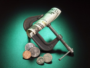 Money squeeze as a metaphor for inflation and increase in taxes