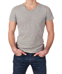 Grey t-shirt on a young man isolated on white background