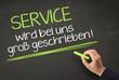Service wird bei uns groß geschrieben! - Slogan auf Kreidetafel