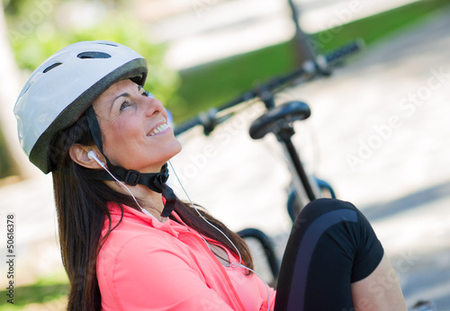Sporty Woman Listening To Music