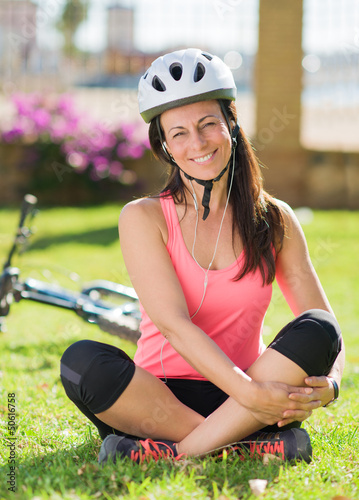 Cyclist Woman Listening To Music