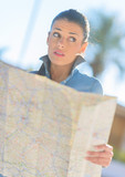 Scared Woman Holding Map