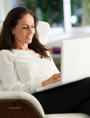 Happy Mature Woman Working On Laptop