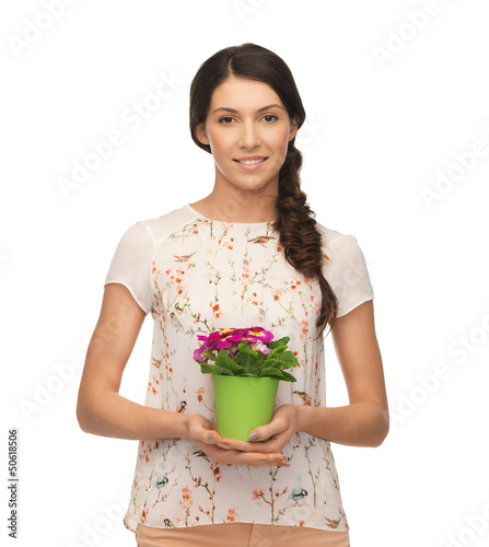 lovely housewife with flower in pot
