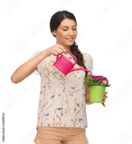 housewife with flower in pot and watering can
