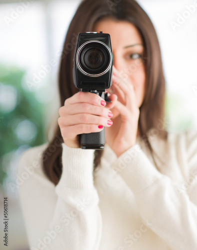 Portrait Of Woman Using Camcorder