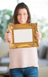Happy Woman Holding Picture Frame
