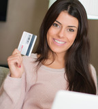Portrait Of Woman Holding Credit Card