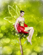 Gorgeous young woman as spring fairy
