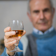 Old man making a toast(drinking)