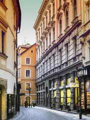 Evening mood in narrow street in Prague