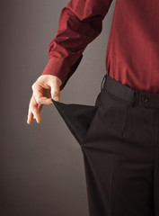 Businessman turning his empty pocket inside out