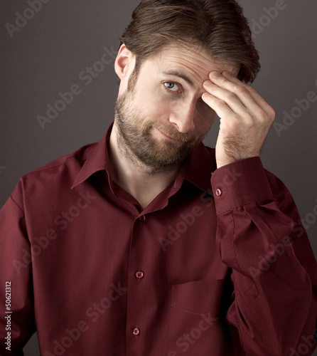 Forty years old confused man scratching his head