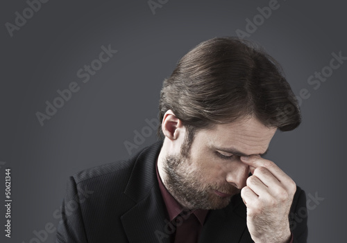 Forty years old depressed and overwhelmed businessman