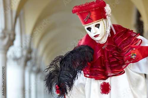 Venetian costume attends Carnival of Venice.