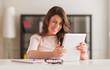 Young Woman Looking At Digital Tablet