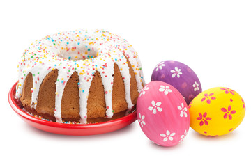 easter cake and colorful eggs on white
