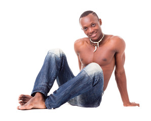 young man wearing only jeans and sitting