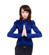 Businesswoman with hands in prayer