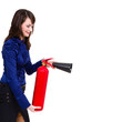 young businesswoman using a fire extinguisher