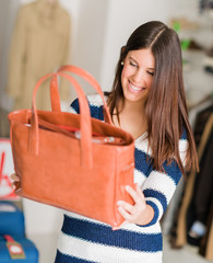 Happy Woman Looking At Hand Bag